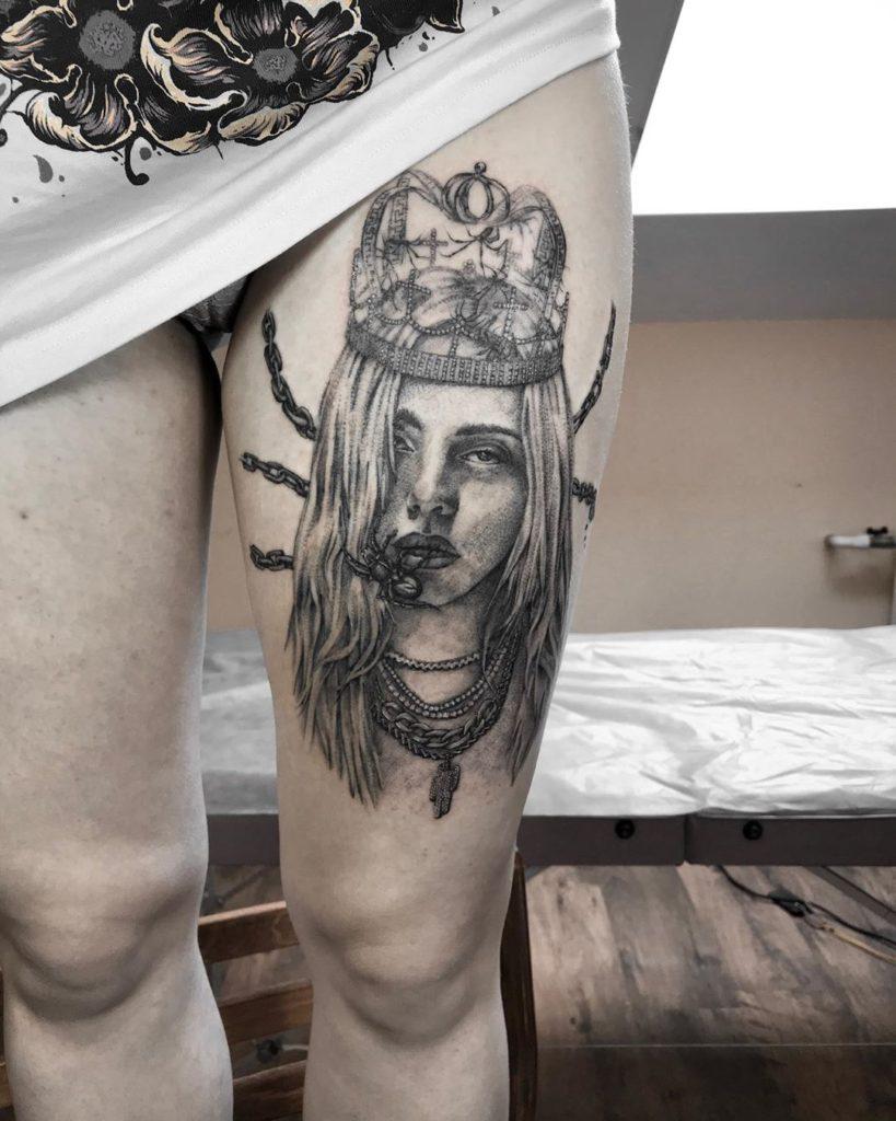 Billie Eilish portrait tattoo on Thigh - Black and Grey style by Lena Streltsova