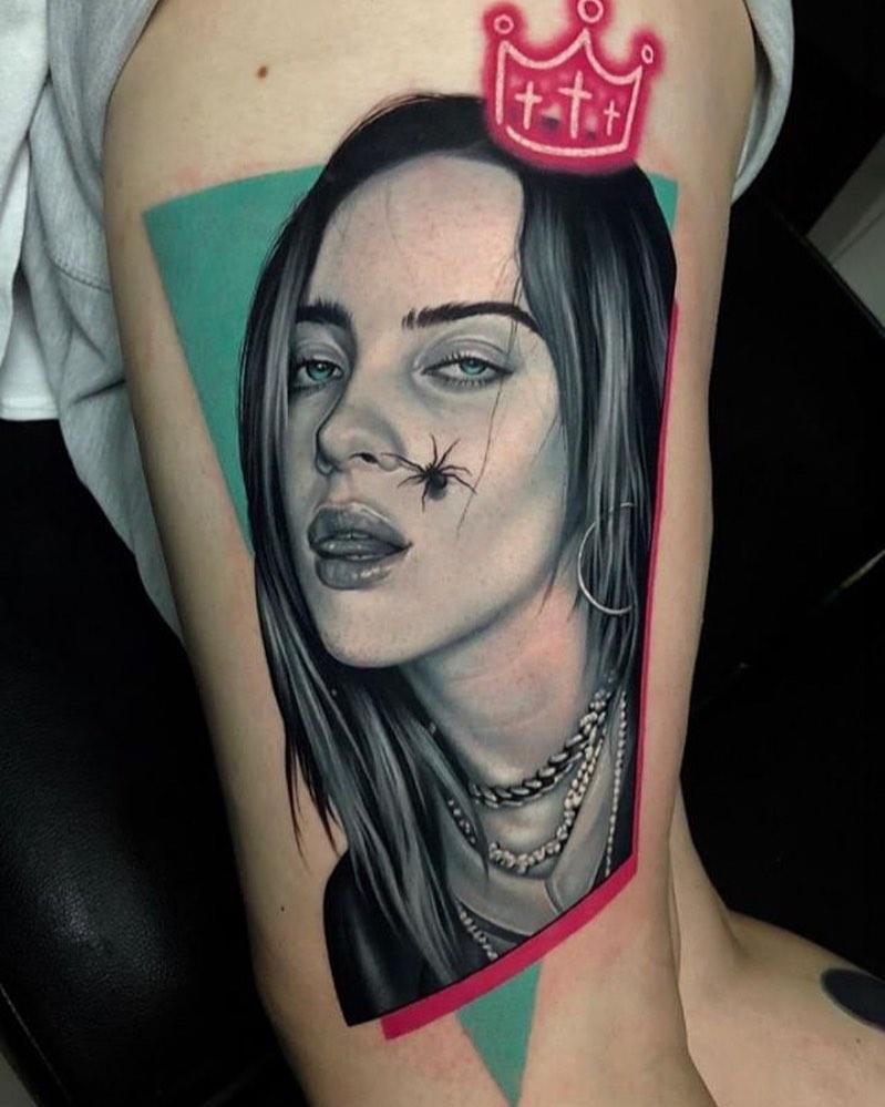 Billie Eilish portrait tattoo on Thigh (side) - Realism style by Mihail Kogut