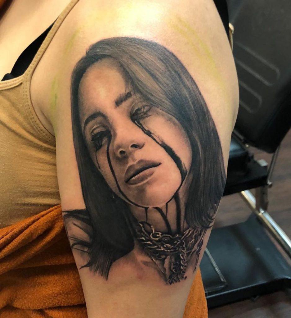 Billie Eilish portrait tattoo on Arm (upper) - Black and Grey style by David Thao