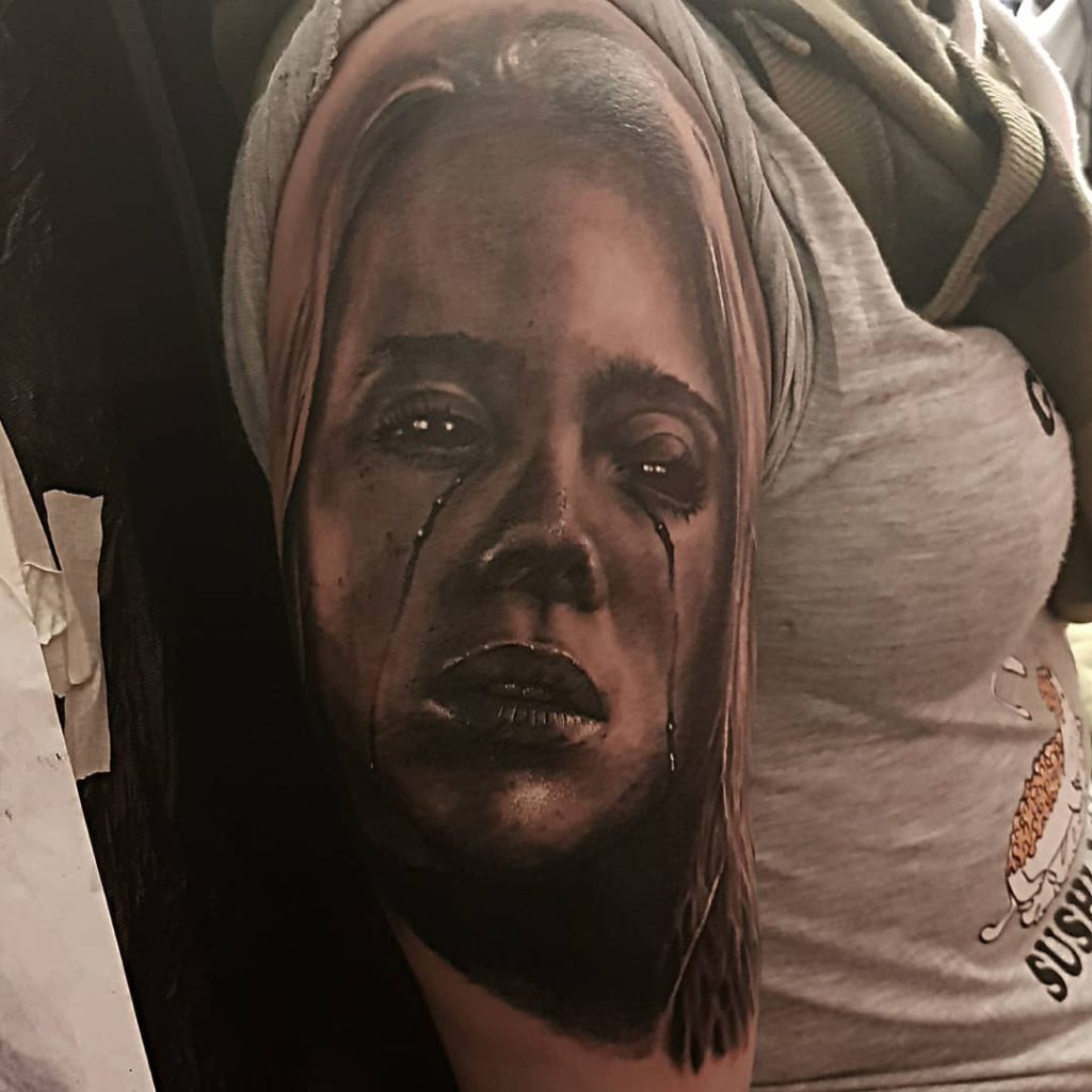 Billie Eilish portrait tattoo on Arm (upper) - Black and Grey style by Ville Kantola