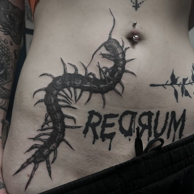 Centipede tattoo on Stomach - Blackwork style by Julia Crow