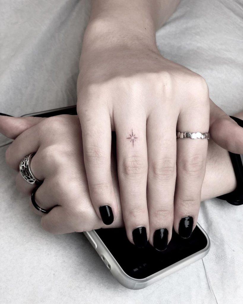 Star tattoo on Finger by Sana