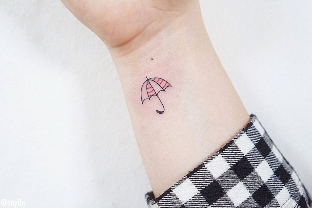 Umbrella tattoo on Wrist (inner) by Seyoon