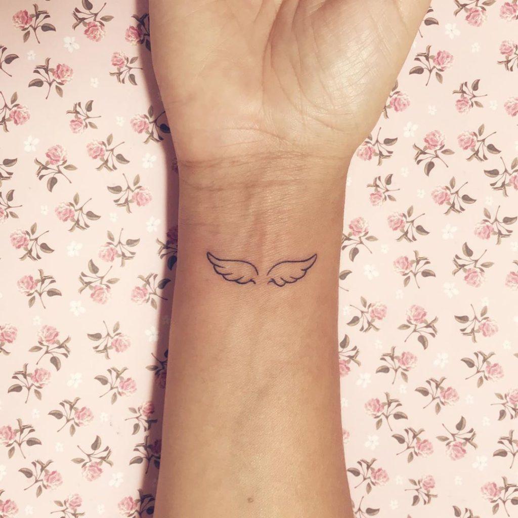 Wing tattoo on Wrist (inner) by Luana Dórea