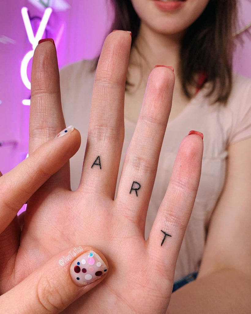 Writing tattoo on Finger by Masha Vivo