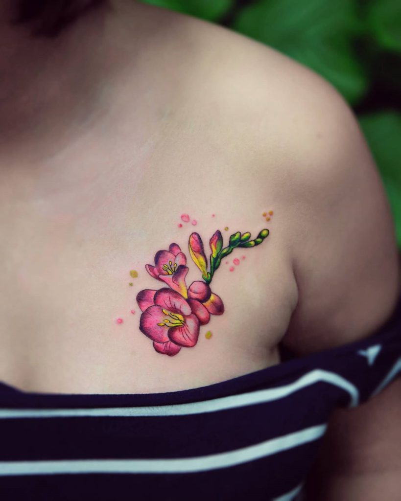 freesia tattoo on Chest - Color style by Ewa Czub