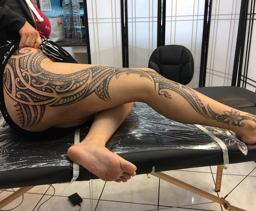 Polynesian leg sleeve tattoo on a woman