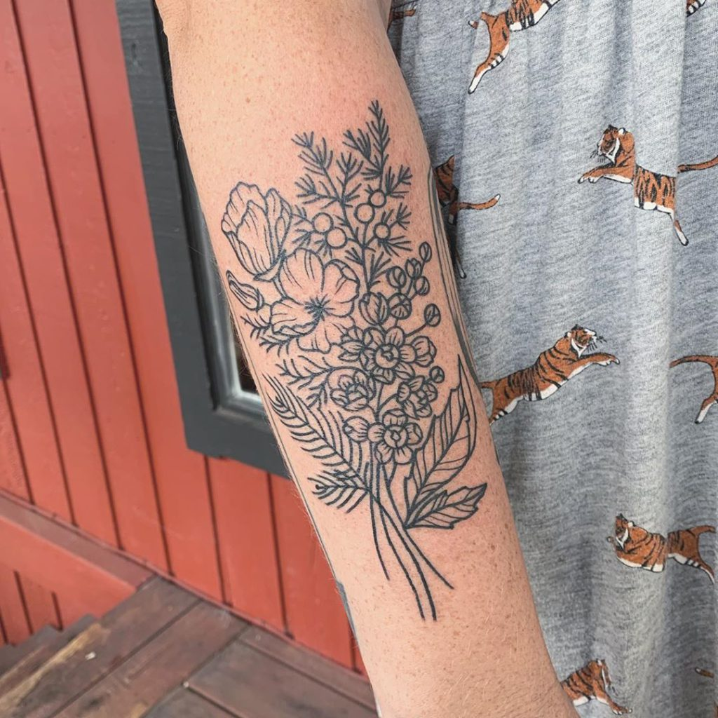 Flower tattoo on Forearm (back) by conniegabbert