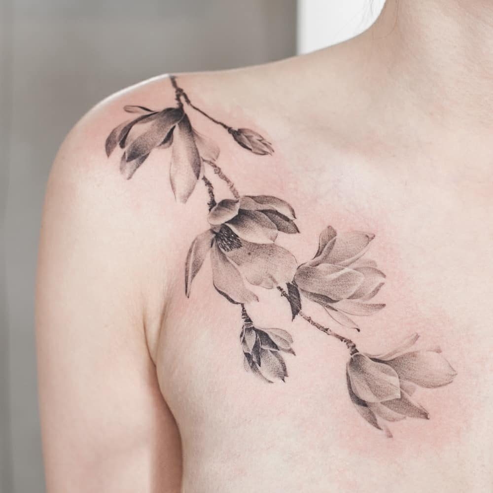 Magnolia tattoo on Shoulder by graffittoo