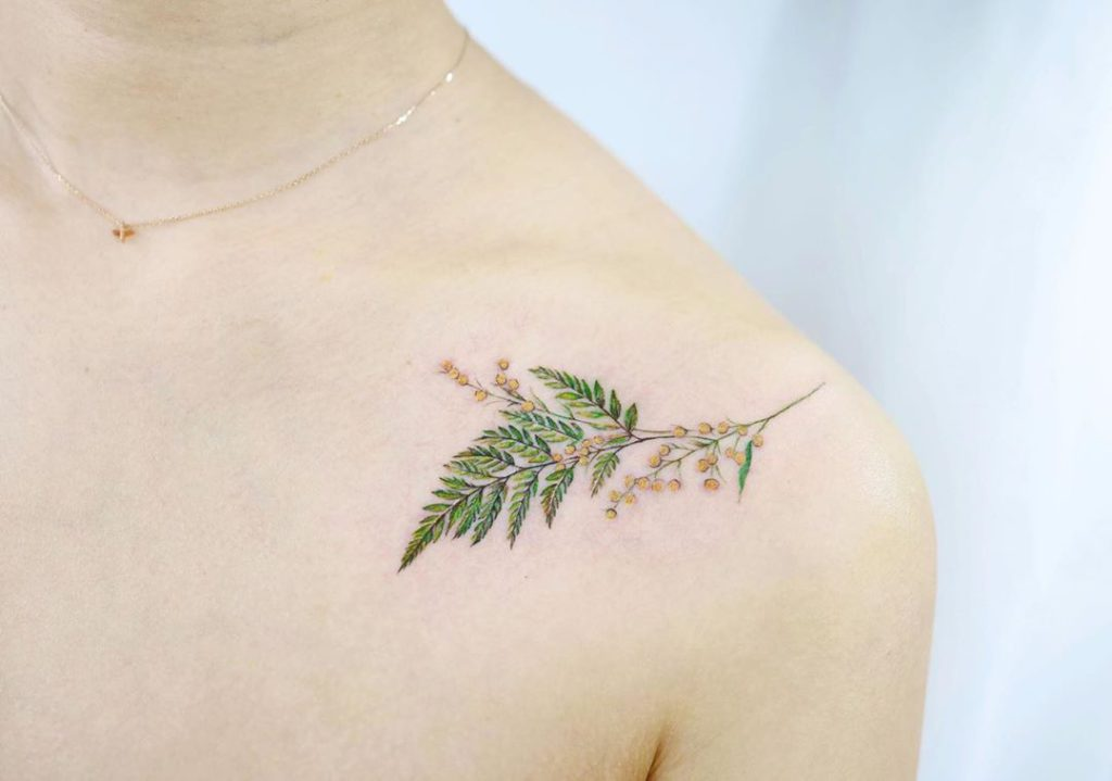 Botanical tattoo on Collarbone by Vanessa