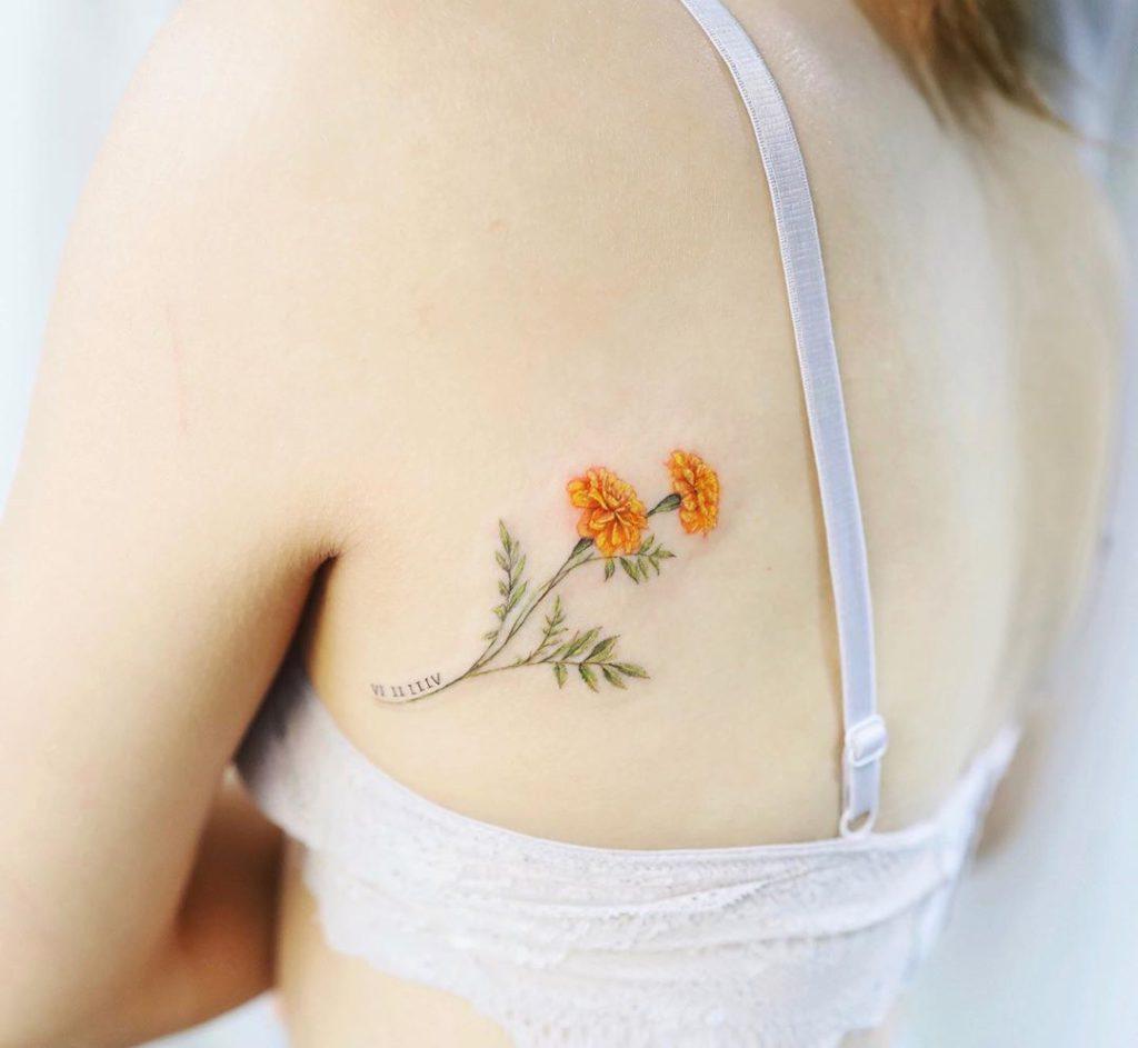 Marigold tattoo on Back by Vanessa