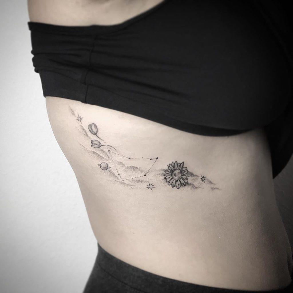 Capricorn tattoo on Rib - Fine Line style by Babri