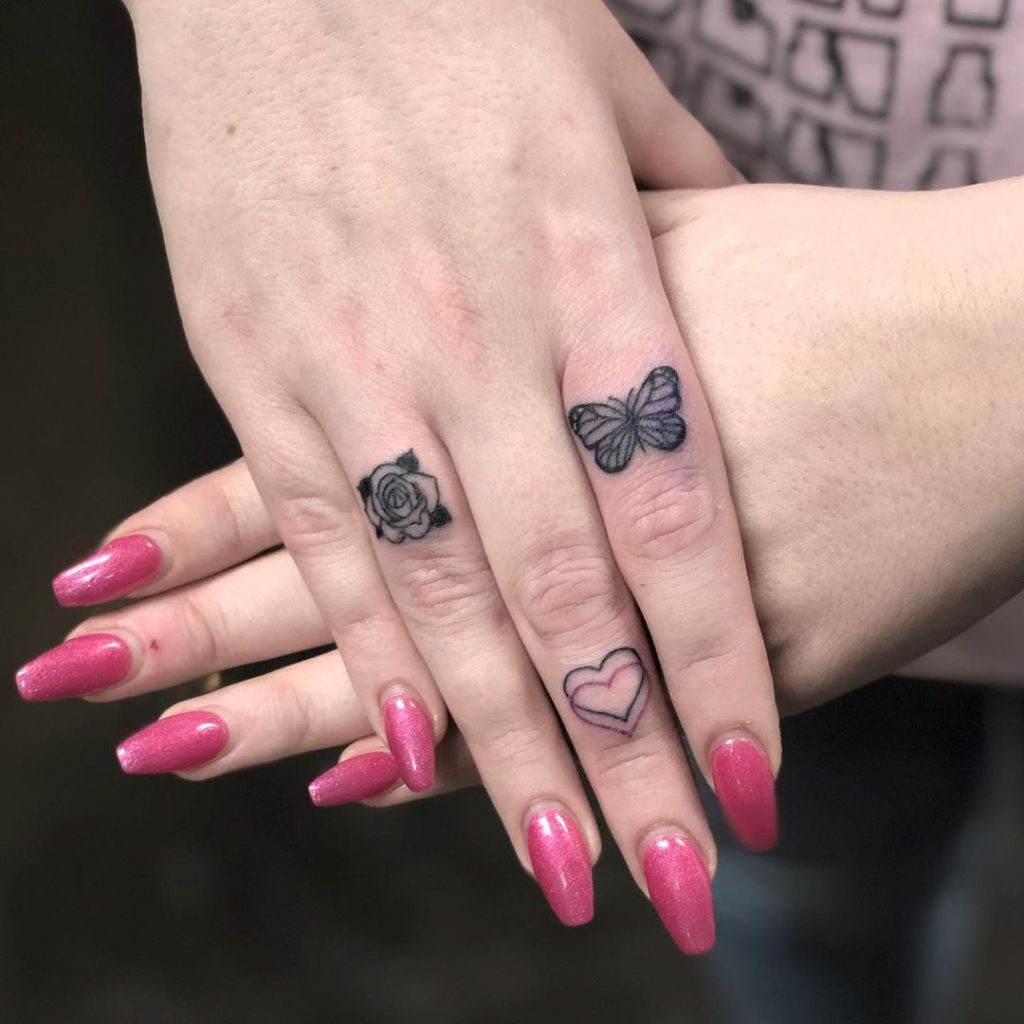 Flower tattoo on Finger by Kelcie Waslenko