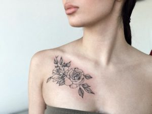 Flower tattoo on Collarbone by Astana