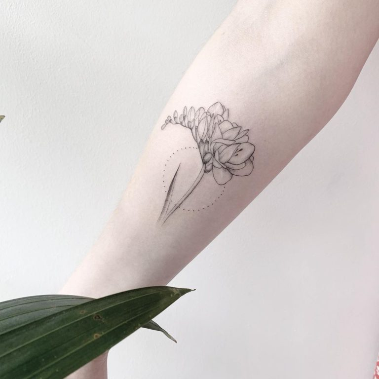 Freesia tattoo on Forearm (inner) by Vivien Szincsak