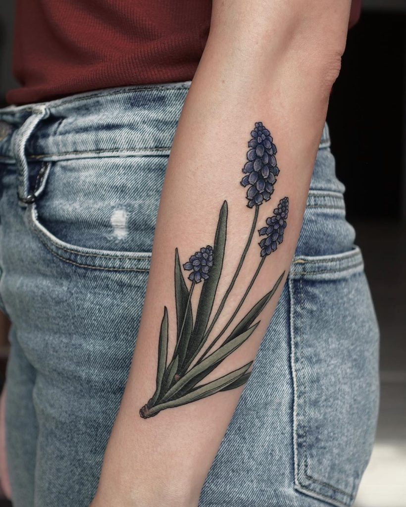 Grape hyacinth tattoo on Forearm (back) by Olga Nekrasova