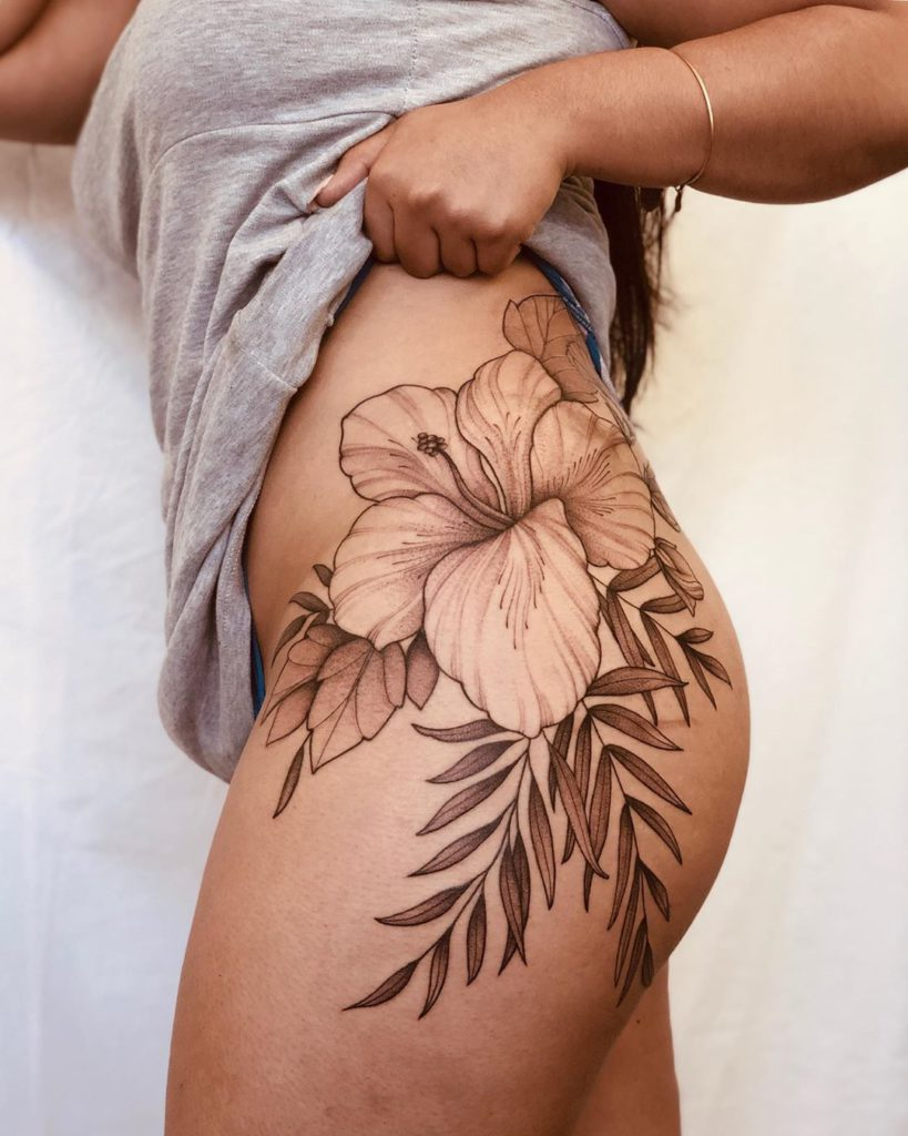 Hibiscus tattoo on Hip by Lianna