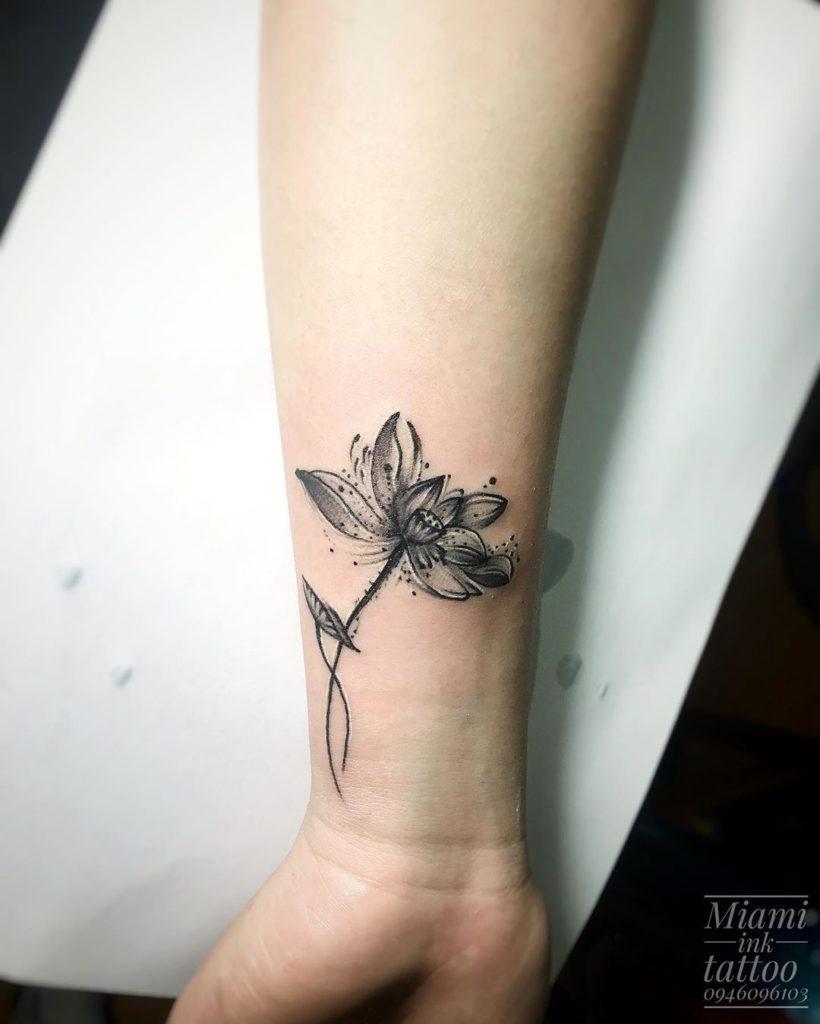 Lotus tattoo on Wrist (inner) by Thành Te Te