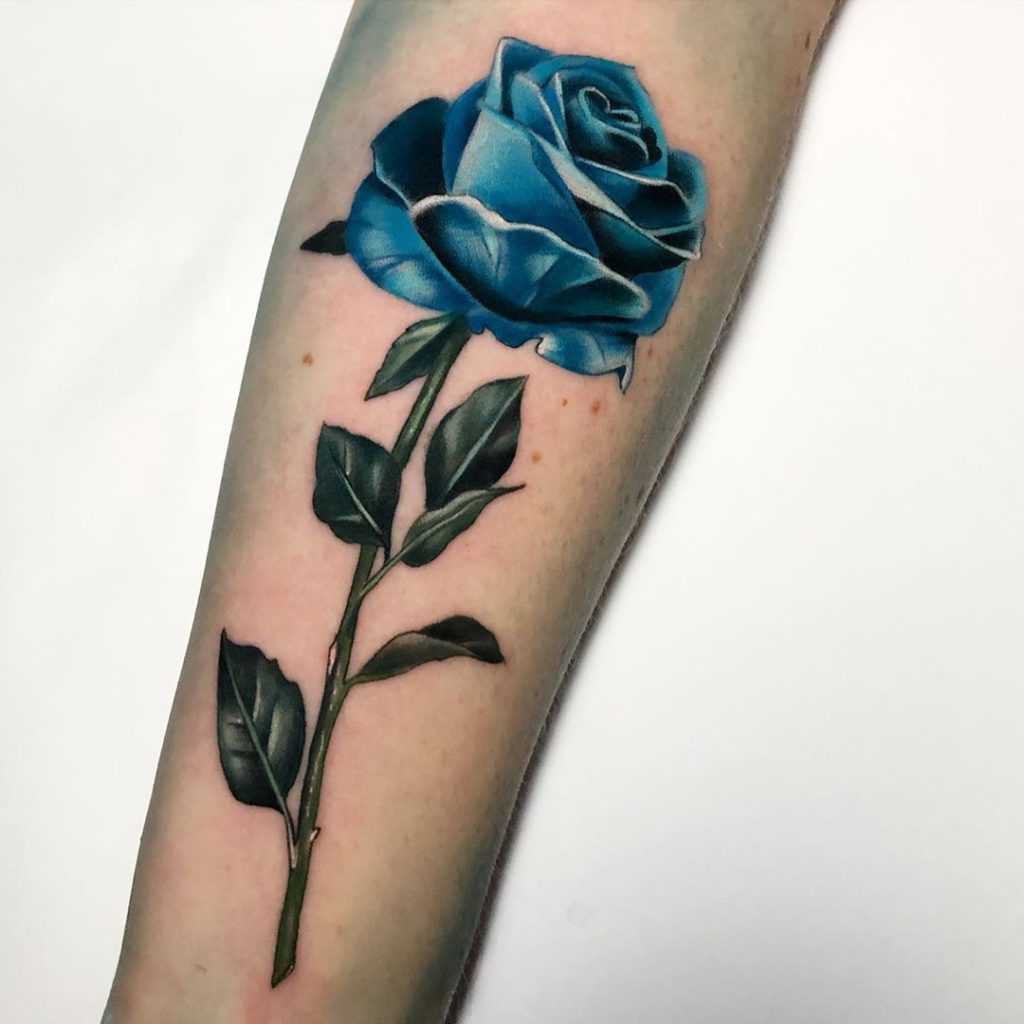 Rose tattoo on by Leanne Fate