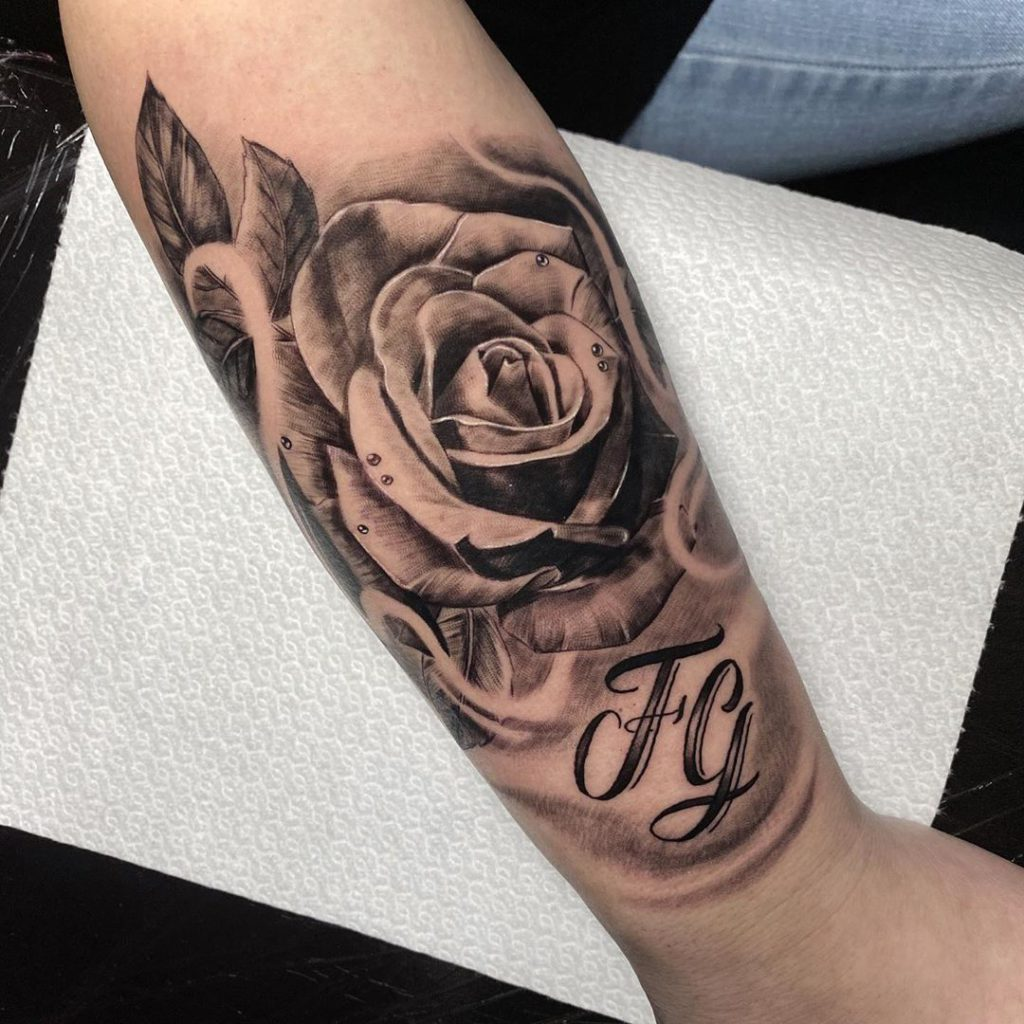Rose tattoo on by Roman Monteban Tattoos