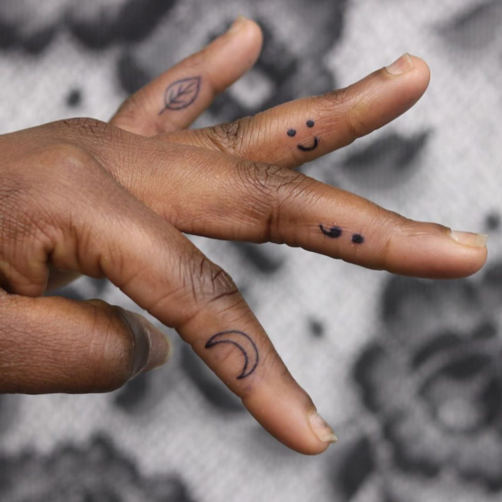 Semicolon Tattoo on Finger by kat