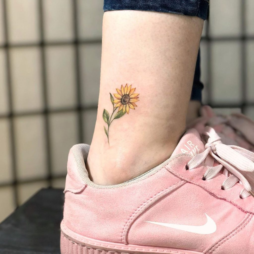 Sunflower tattoo on Ankle by Sasha Vorobiova